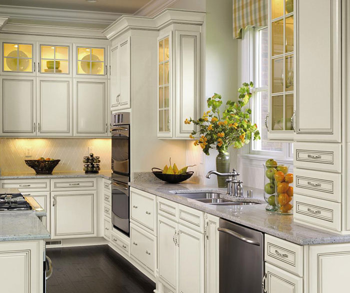 Off white cabinets with glaze by Decora Cabinetry