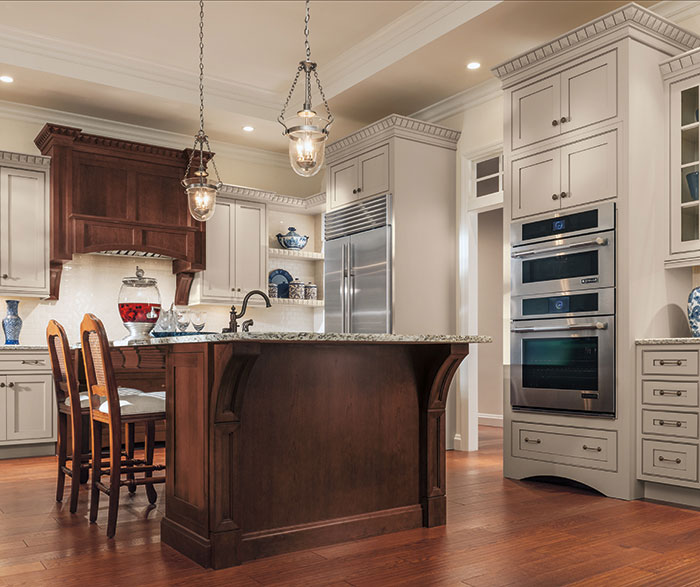 Painted Maple cabinets with a Cherry kitchen island by Decora Cabinetry