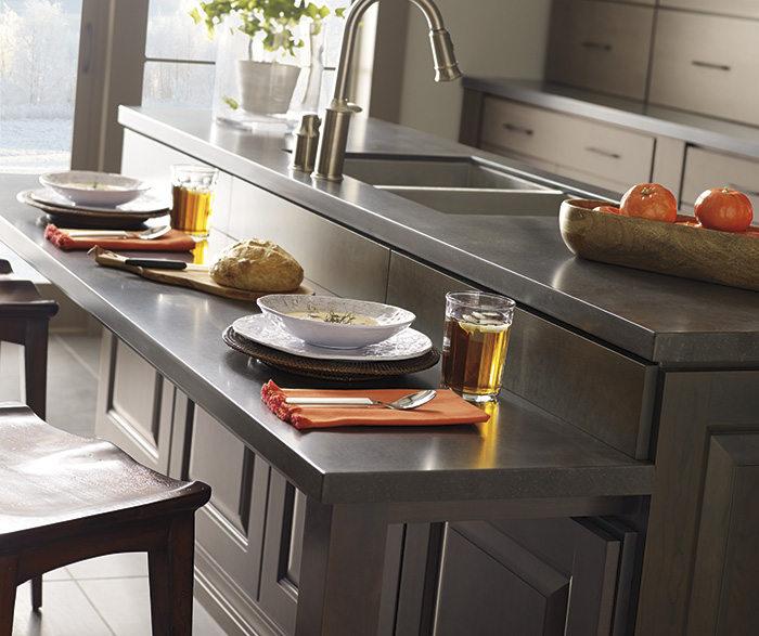 Gray kitchen island with Cherry cabinets by Decora Cabinetry
