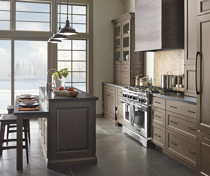 Gray kitchen cabinets with island by Decora Cabinetry